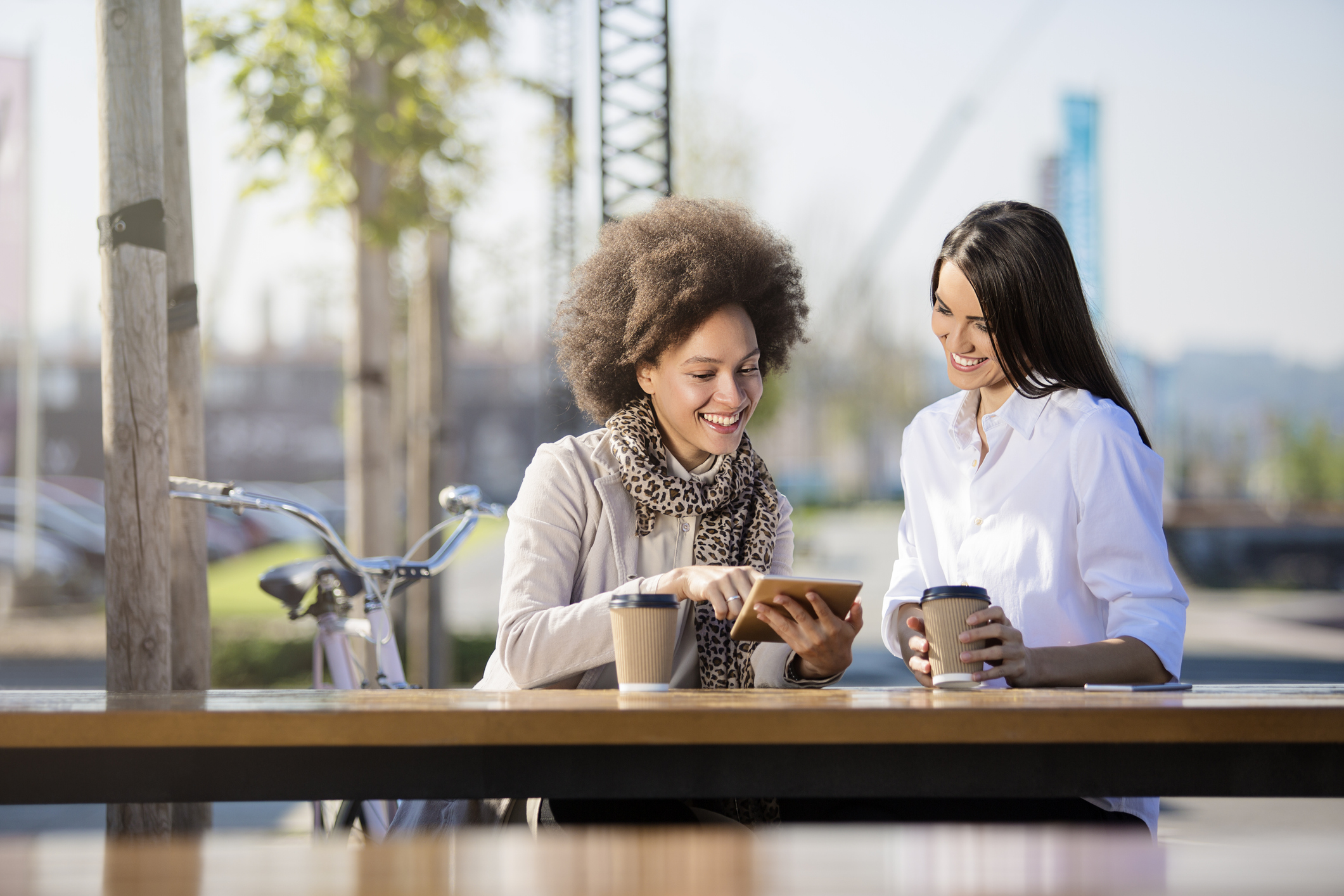 Women having coffee and talking outside